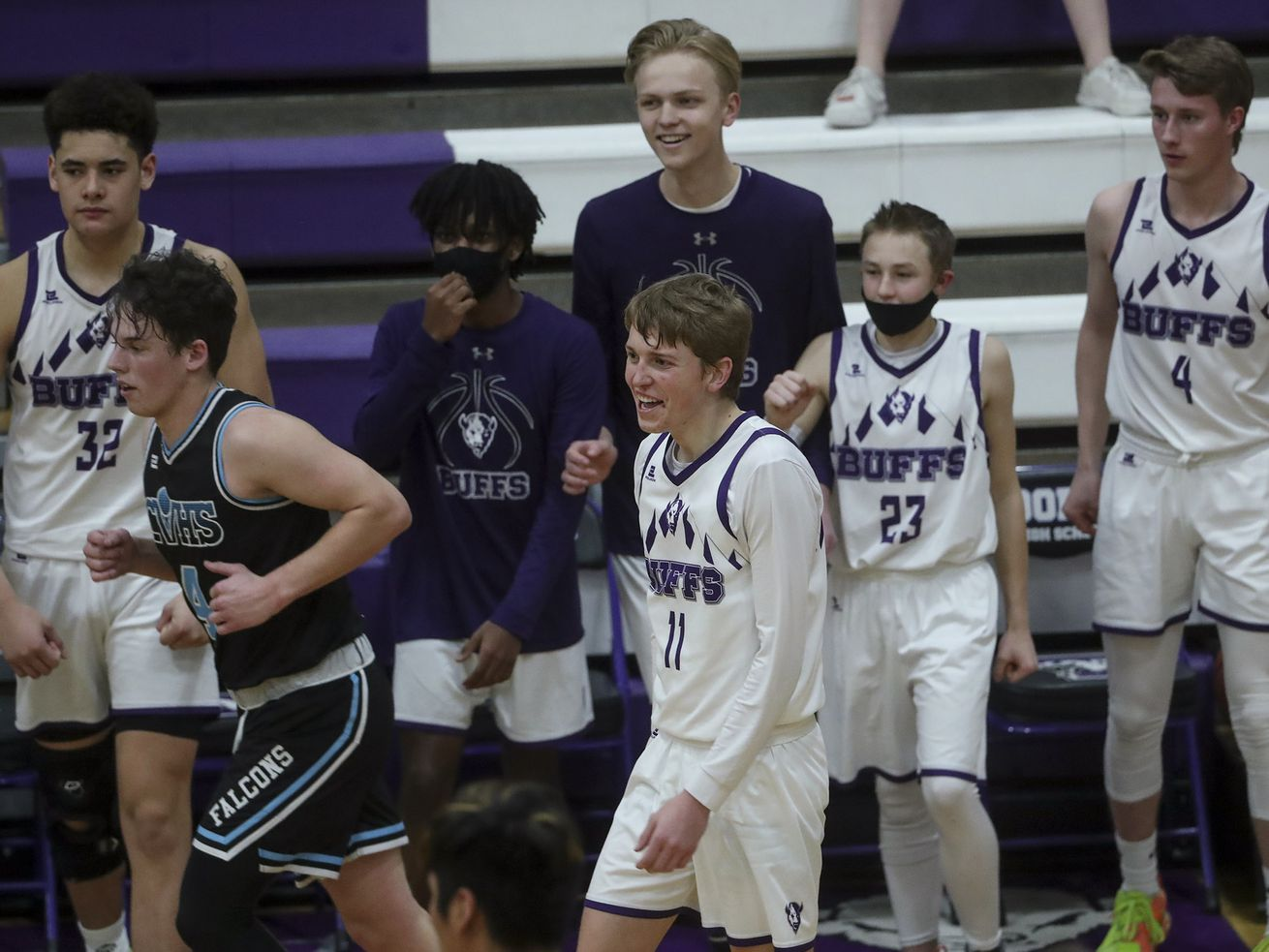 Tooele's McCade Laughlin smiles after he nailed a 3-pointer to end the third quarter during the first round game against Canyon View during the 4A basketball tournament at Tooele High School on Tuesday, Feb. 23, 2021.