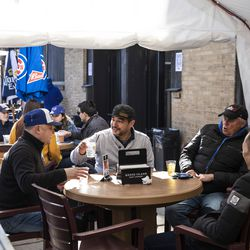 Anthony Reyes (center, in grey), of Bucktown, drinks with friends at Sluggers World Class Sports Bar during the Chicago Cubs Opening Day game against the Pittsburgh Pirates.