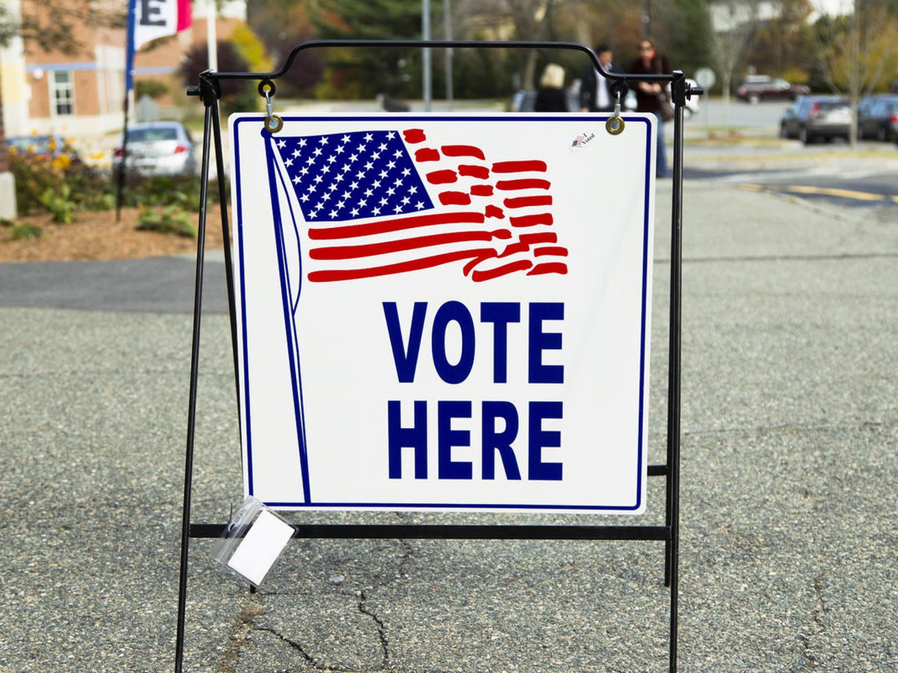A sign shows an election polling place during a United States election.