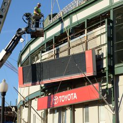 3:14 p.m. The third segment of the marquee being lifted away from the ballpark -