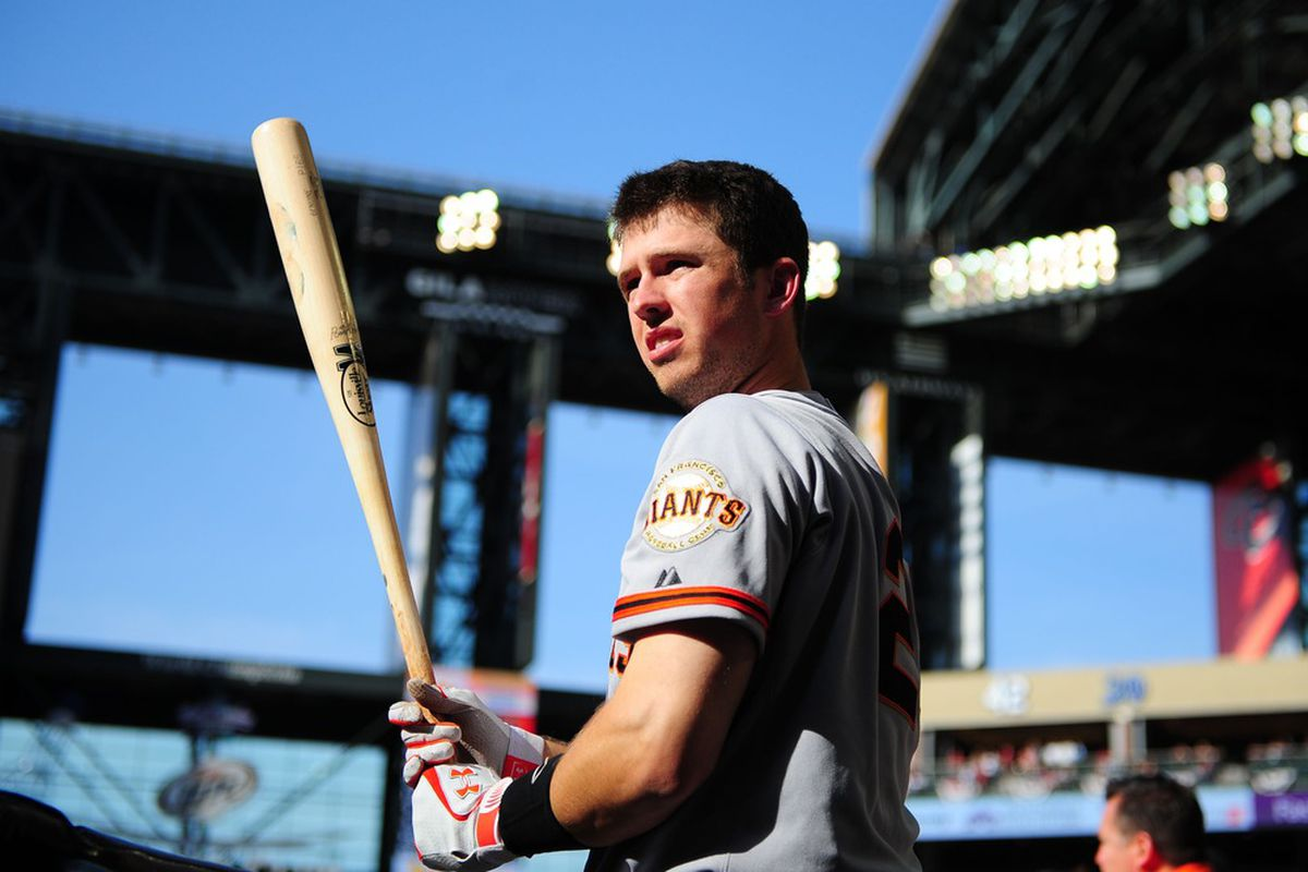 Apr. 6, 2012; Phoenix, AZ, USA; San Francisco Giants catcher Buster Posey in the dugout in the first inning against the Arizona Diamondbacks during opening day at Chase Field.  Mandatory Credit: Mark J. Rebilas-US PRESSWIRE