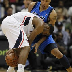 Atlanta Hawks guard Joe Johnson, left, is defended by Dallas Mavericks forward Shawn Marion in the first half of an NBA basketball game on Thursday, April 26, 2012, in Atlanta.