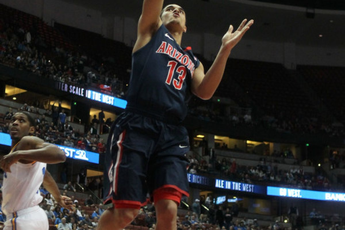 ANAHEIM, CA - JANUARY 05:  Nick Johnson #13 of the Arizona Wildcats goes up for a shot against the UCLA Bruins at the Honda Center on January 5, 2012 in Anaheim, California.  (Photo by Stephen Dunn/Getty Images)