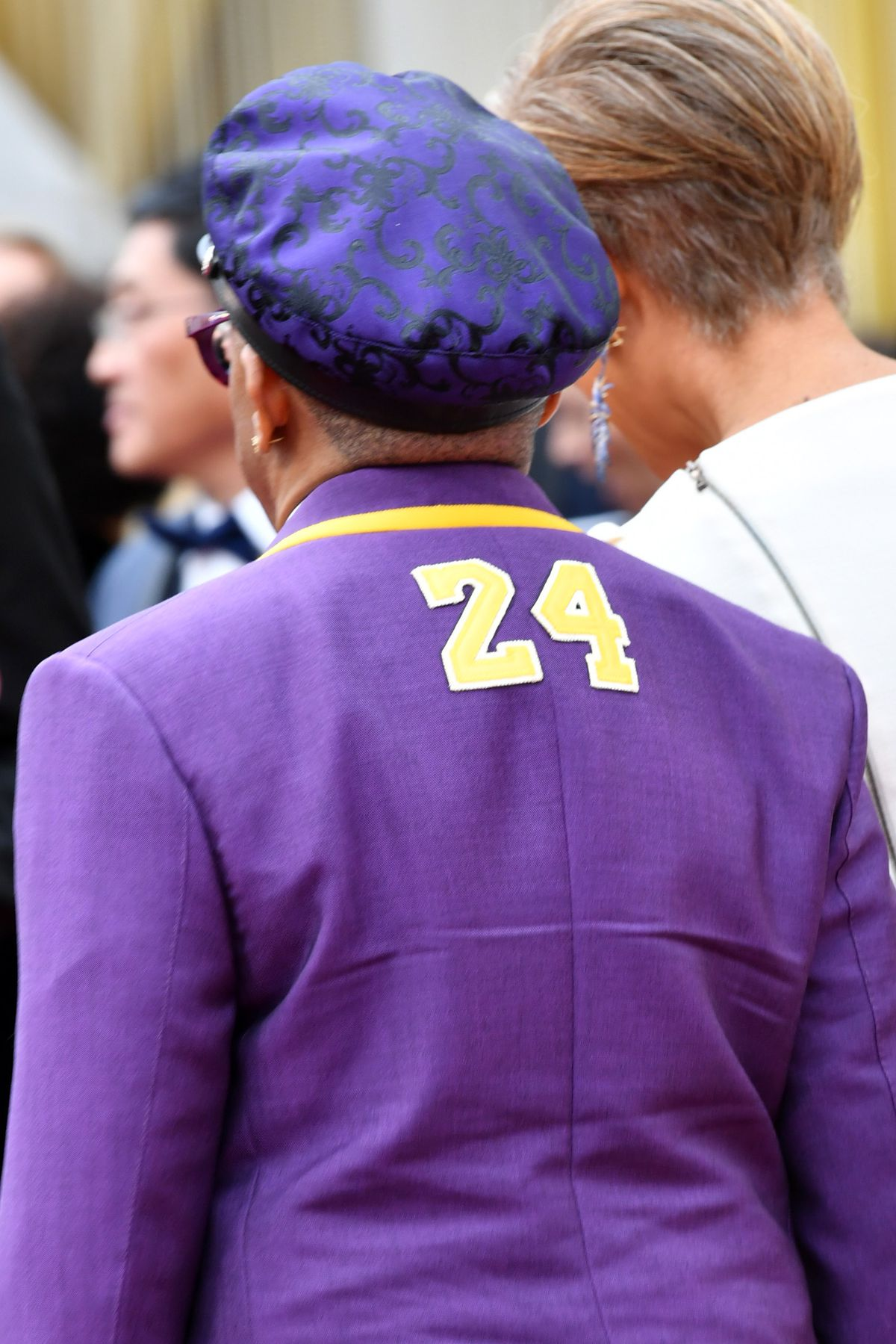 Spike Lee arrives at the Academy Awards on Sunday night, wearing a purple and gold tribute to No. 24, Kobe Bryant.