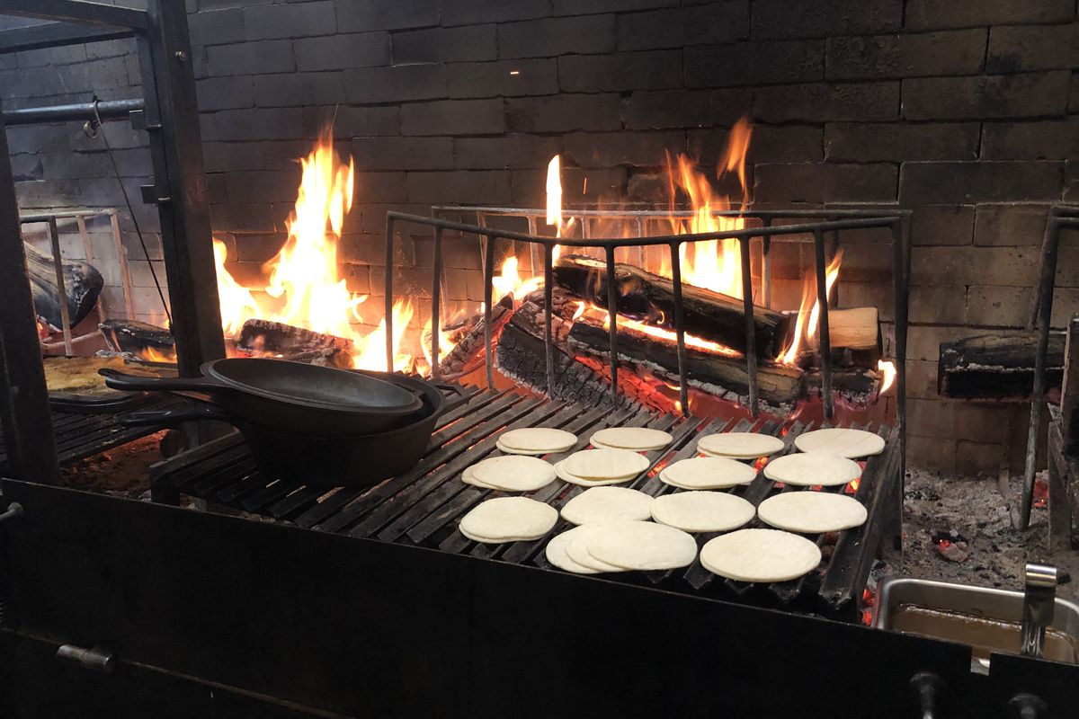 Flower tortillas on a grill grate over fire