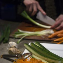 In the early afternoon, vegan Chef Molly Aubuchon preps cucumbers, carrots, onion and other vegetables for her vegan sushi to put in maki rolls for dinner Monday, Feb. 8, 2016, in her Kent, Ohio, home.