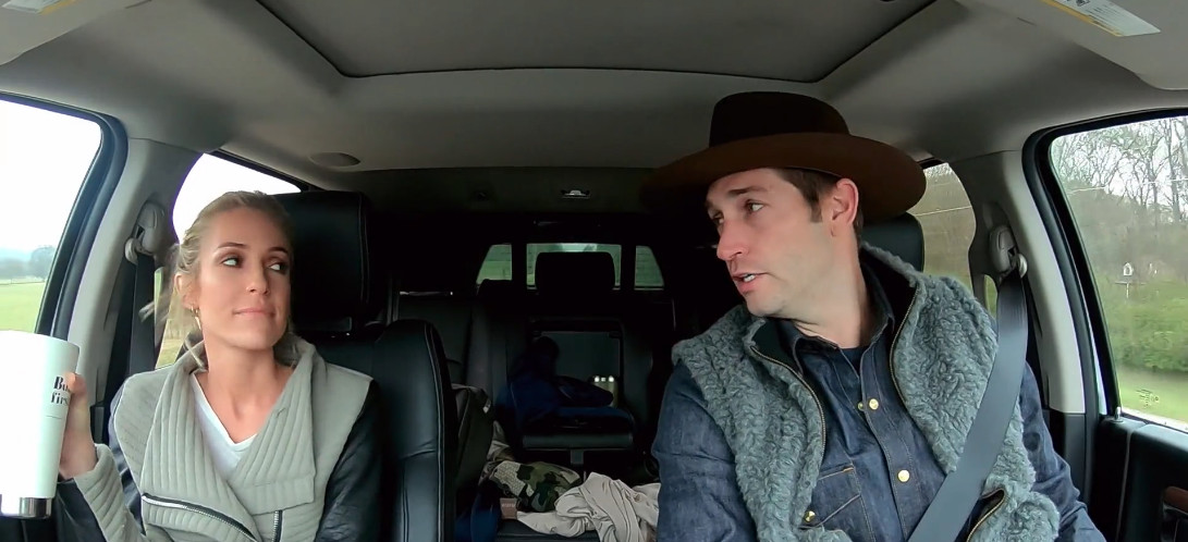 Kristin Cavallari and Jay Cutler in a car. Jay is wearing a brown hat.