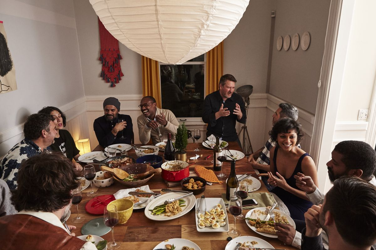 Members of the supper club around the table.