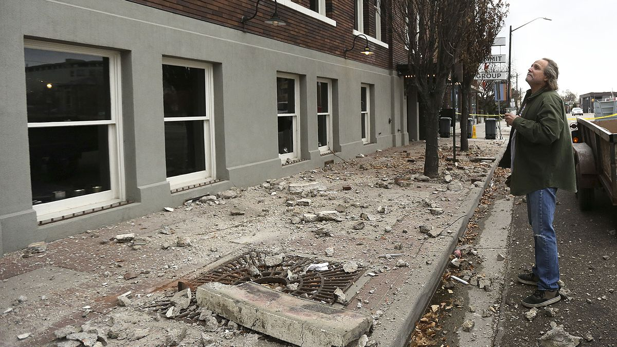 Curtis Green looks at the damage to BTG Wine Bar and Caffe Molise in Salt Lake City after a 5.7 magnitude earthquake centered in Magna hit early on Wednesday, March 18, 2020.