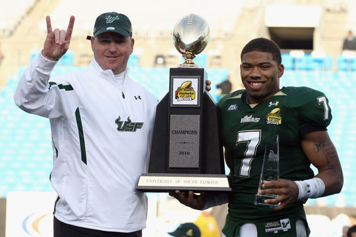 CHARLOTTE NC - DECEMBER 31:  Head coach Skip Holtz stands with MVP B.J. Daniels #7 of the USF Bulls after a 31-26 victory over the Clemson Tigers.  USF replaces Arkansas as UTEP's BCS conference foe in 2011. (Photo by Streeter Lecka/Getty Images)