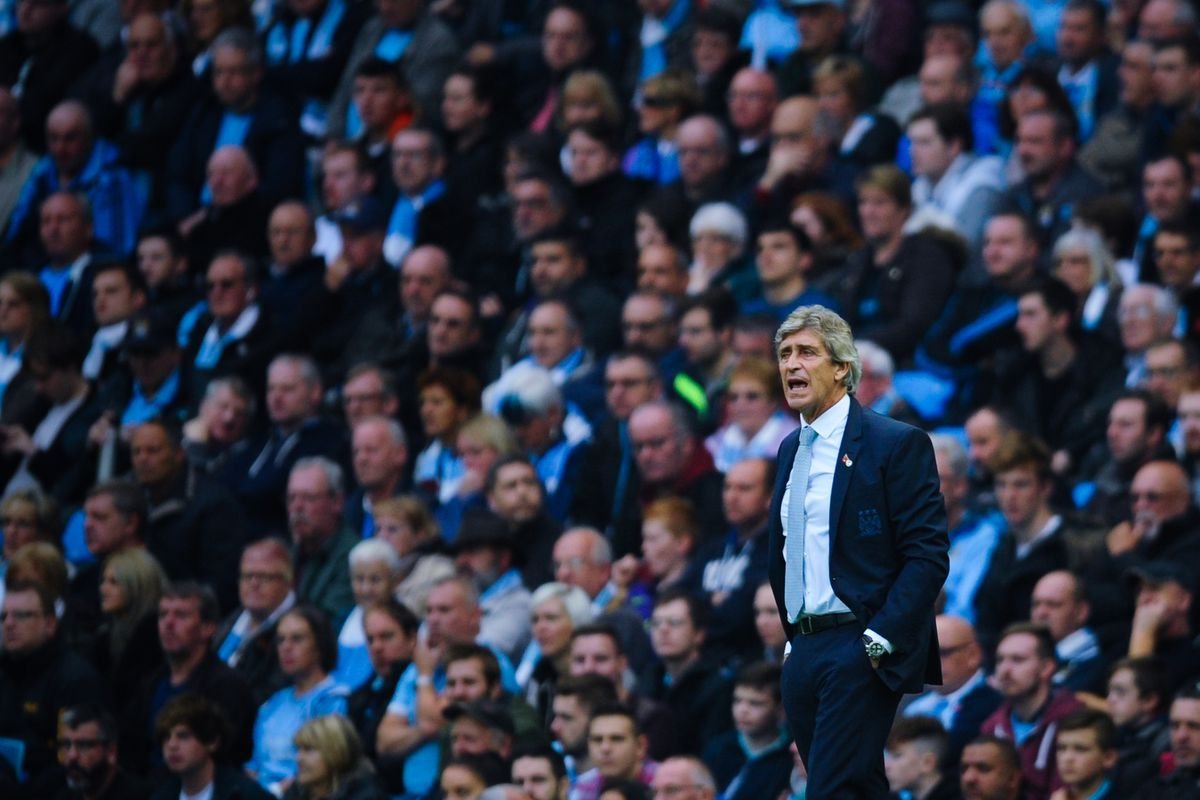 Manuel Pellegrini looks on during the Barclays Premier League match between Manchester City and Norwich City at Etihad Stadium on October 31, 2015 in Manchester, England.