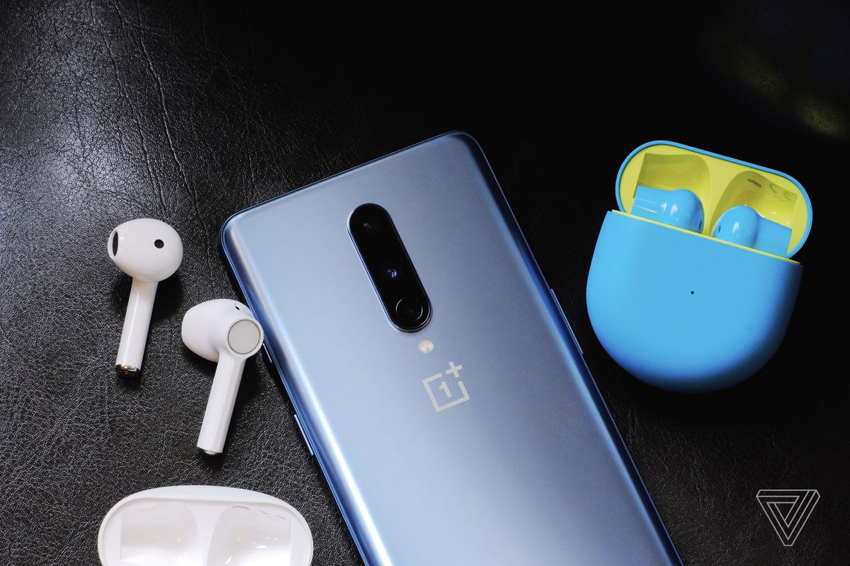A photo of the white and blue/green OnePlus Buds.
