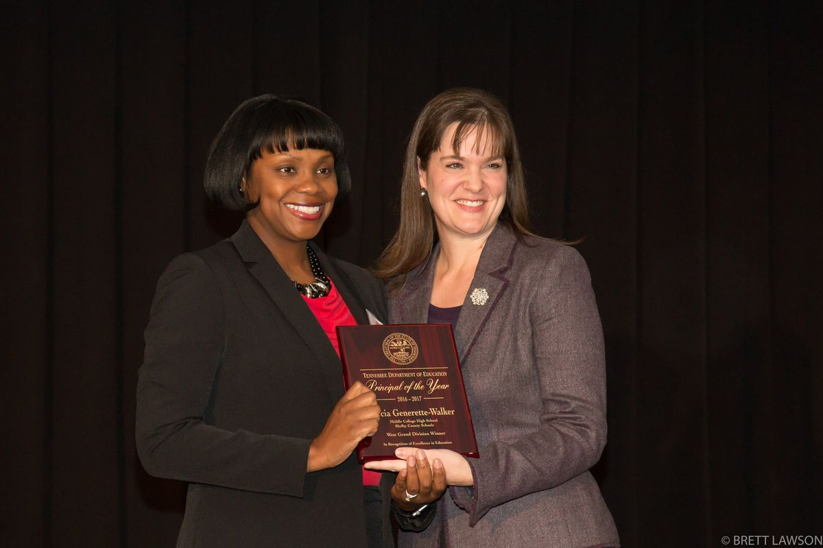 From left: Docia Generette-Walker receives Tennessee's 2016 principal of the year honor from Education Commissioner Candice McQueen. Generette-Walker leads Middle College High School in Memphis.