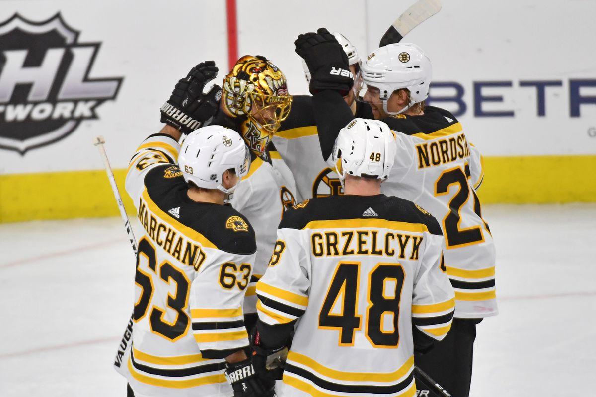 Boston Bruins goaltender Tuukka Rask and teammates celebrate after defeating the Philadelphia Flyers at Wells Fargo Center.