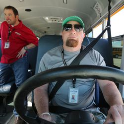 Chris Stevenson drives a school bus with Shaun Adams in American Fork on Friday, March 17, 2017. Alpine School District has added monitors and cameras on its buses to create a safe bus culture to help with bullying.
