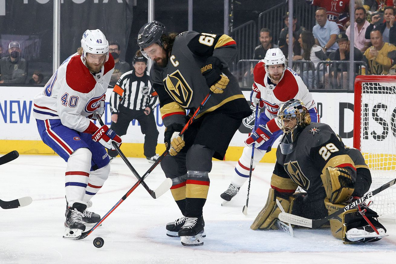 Joel Armia #40 of the Montreal Canadiens and Mark Stone #61 of the Vegas Golden Knights battle for the puck as Marc-Andre Fleury #29 tends net during the first period in Game 5 of the 2021 Stanley Cup Playoffs at T-Mobile Arena on June 22, 2021 in Las Vegas, Nevada.