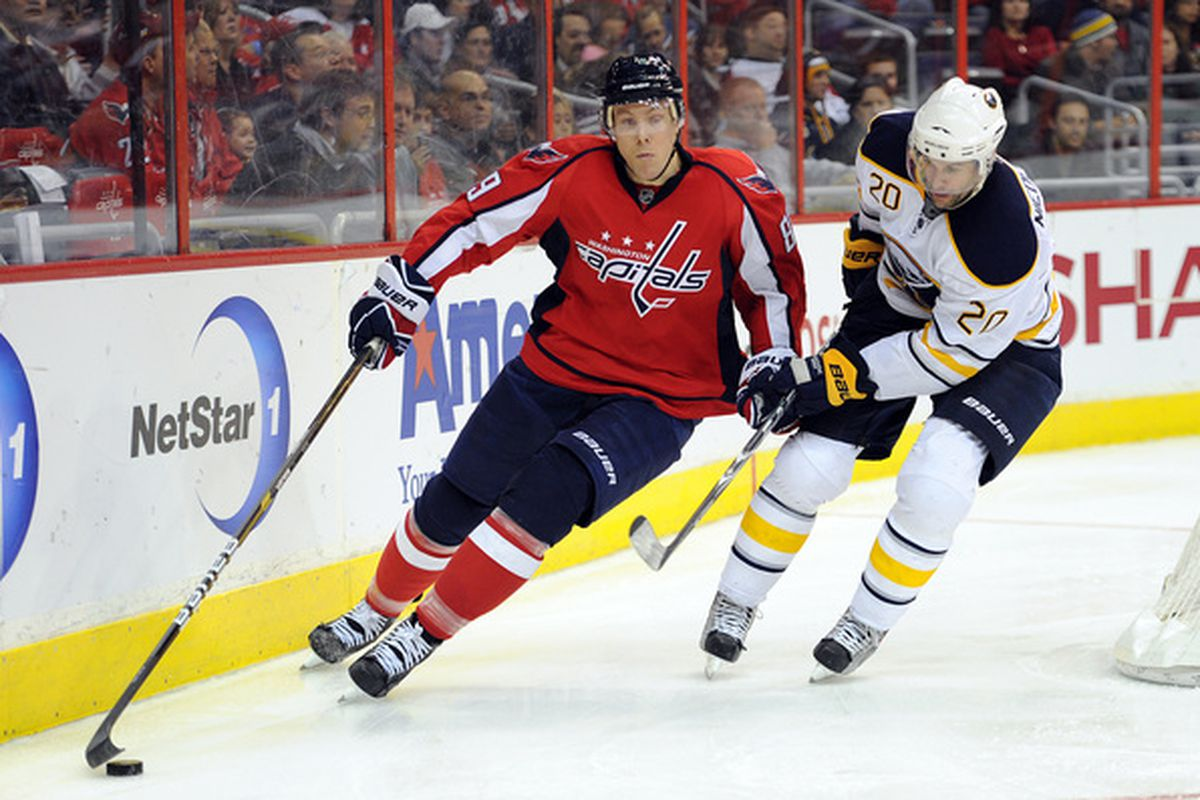 WASHINGTON - NOVEMBER 17:  Tyler Sloan #89 of the Washington Capitals keeps the puck away from Rob Niedermayer #20 of the Buffalo Sabres at the Verizon Center on November 17 2010 in Washington DC.  (Photo by Greg Fiume/Getty Images)