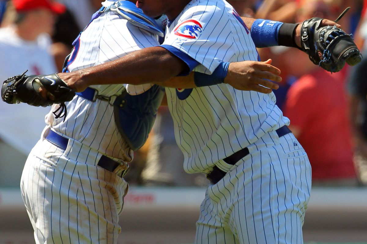 Chicago, IL, USA; Chicago Cubs relief pitcher Carlos Marmol is congratulated for earning a save by catcher Geovany Soto against the St. Louis Cardinals at Wrigley Field. The Cubs won 3-2. Credit: Dennis Wierzbicki-US PRESSWIRE