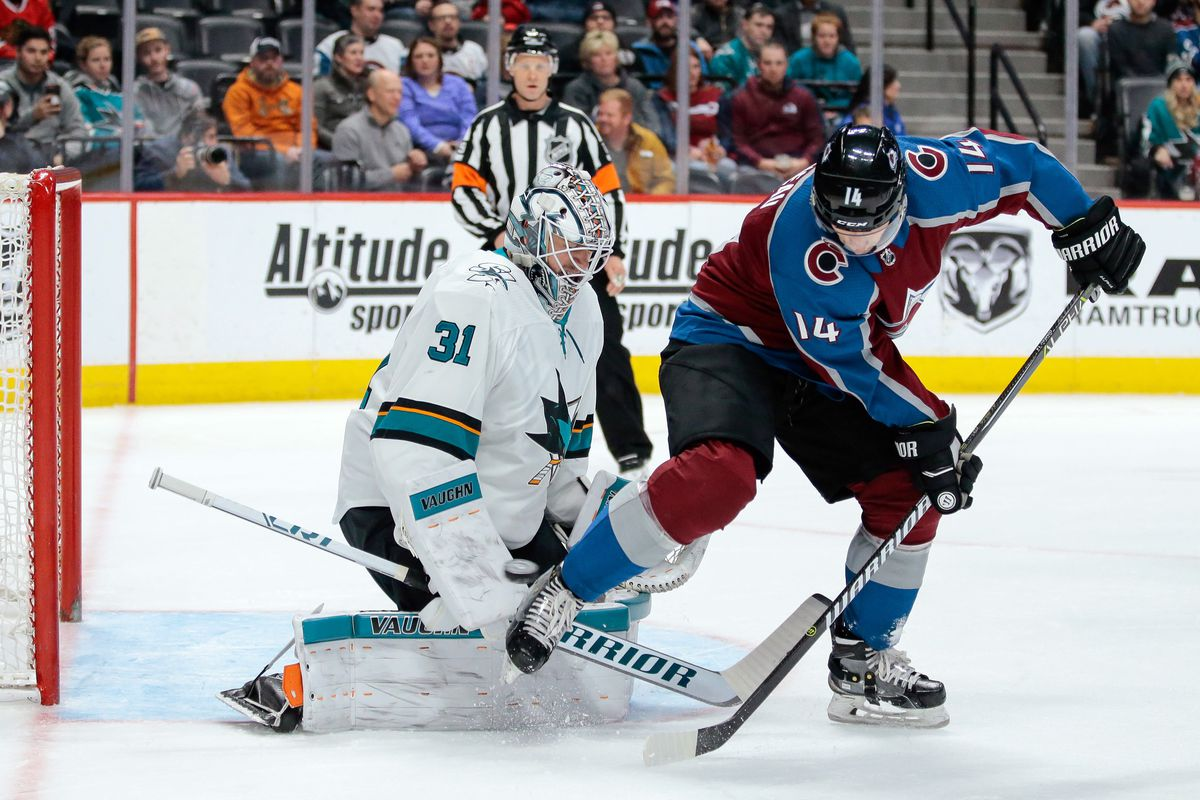 Jan 18, 2018; Denver, CO, USA; San Jose Sharks goaltender Martin Jones (31) makes a save on a deflection from Colorado Avalanche left wing Blake Comeau (14) in the second period at the Pepsi Center.