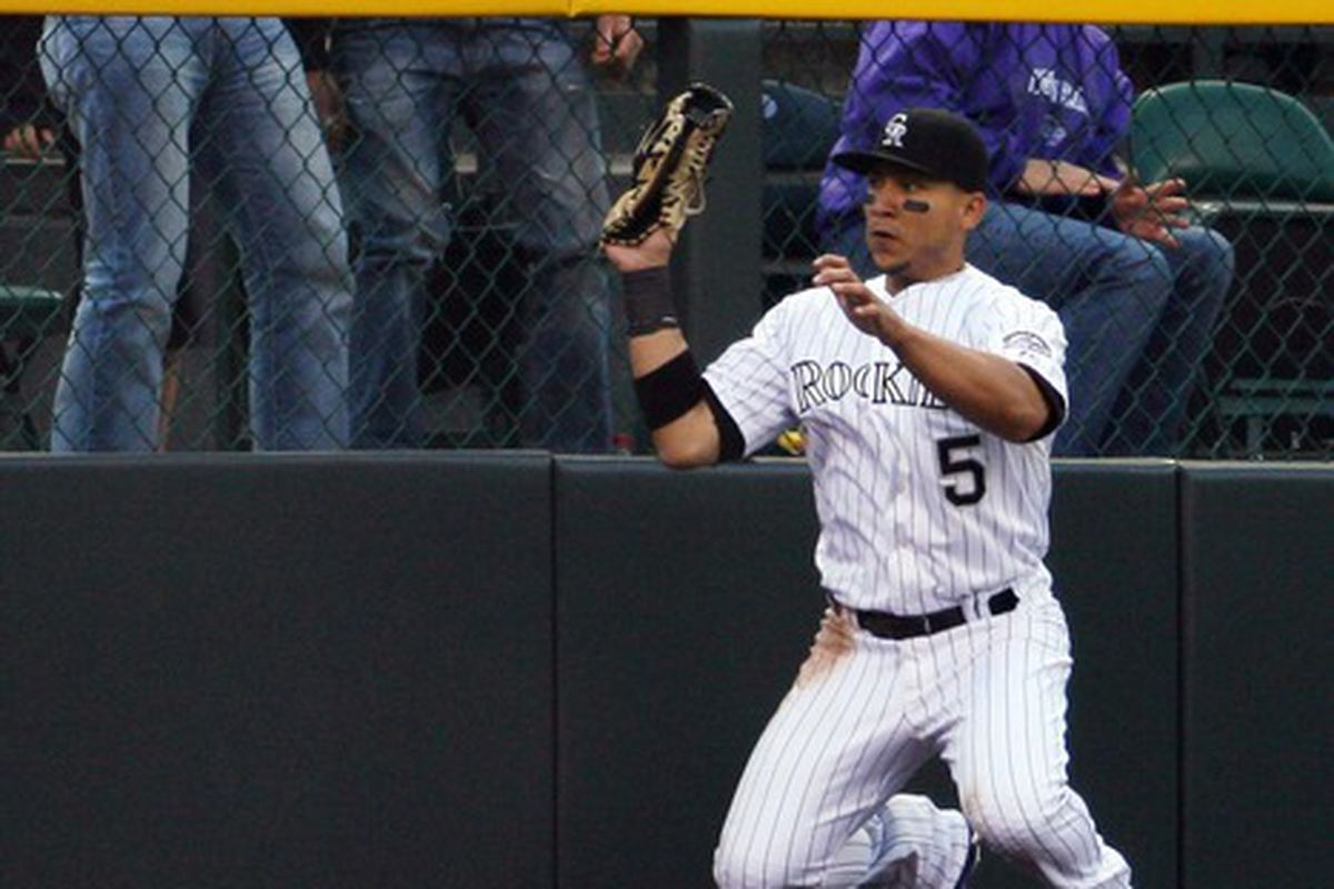 Carlos Gonzalez's aura of awesomeness propels him upward as Rockies fans react to the emitted shockwaves.
