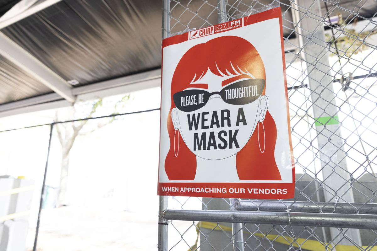 A sign asking for people to wear a mask when shopping at a fair on Day 1 of the Pitchfork Music Festival, Friday, Sept. 10, 2021.