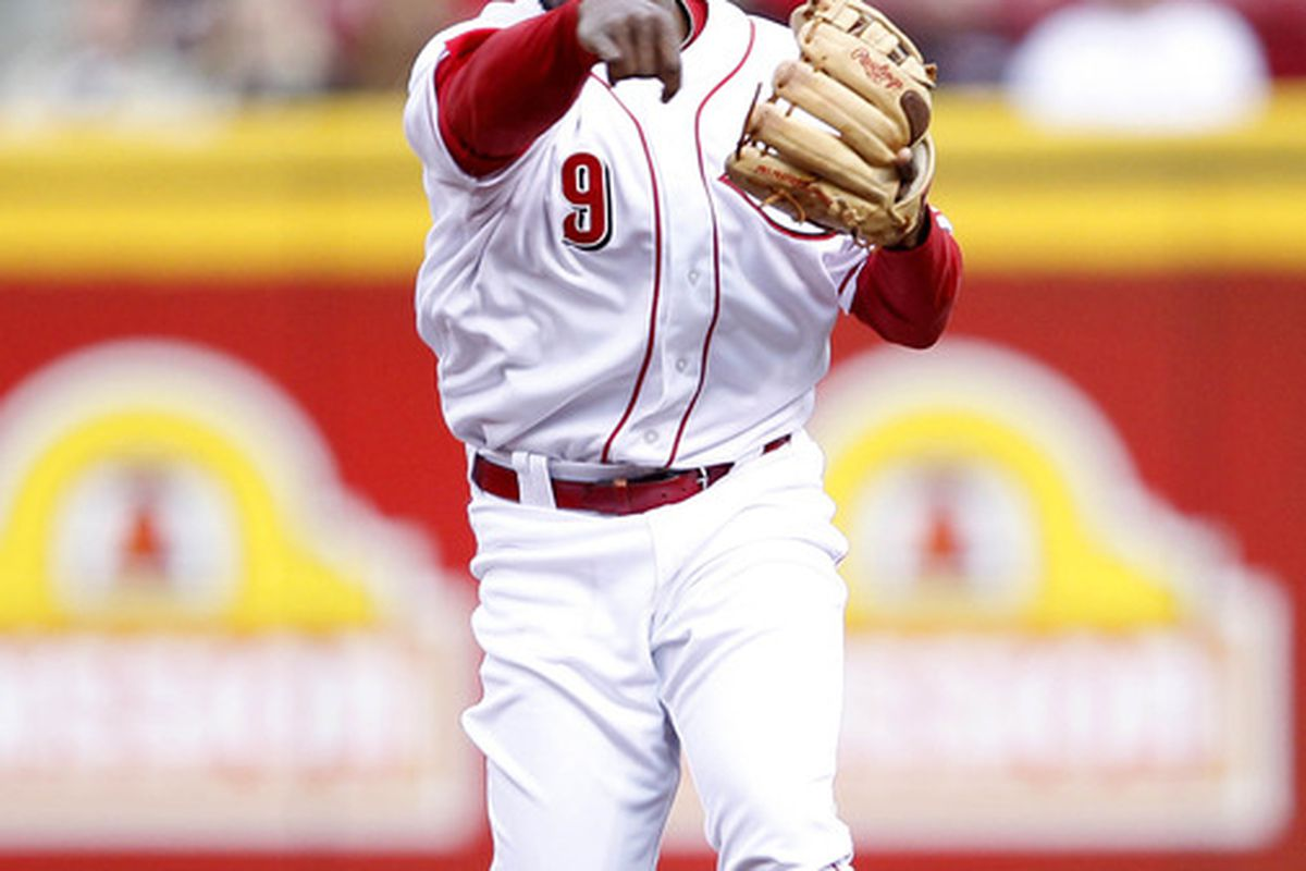 """Apr 10, 2012; Cincinnati, OH, USA; New Reds 2B Willie Harris throws a ball, smirks, and says to himself, """"nah, I couldn't hit that."""""""
