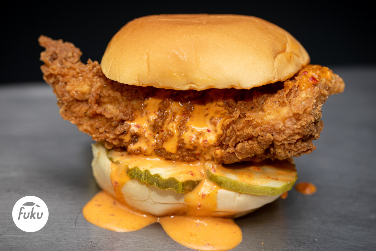 The Fuku sandwich includes a 6-ounce chicken breast cutlet brined in habanero chile puree with pickles, and a spicy Fuku mayo on a Martin's potato roll.