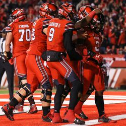 Utah Utes running back Zack Moss (2) celebrates with teammates after scoring, putting the Utes up 7-0 over the Colorado Buffaloes after the PAT, at Rice-Eccles Stadium in Salt Lake City on Saturday, Nov. 25, 2017.