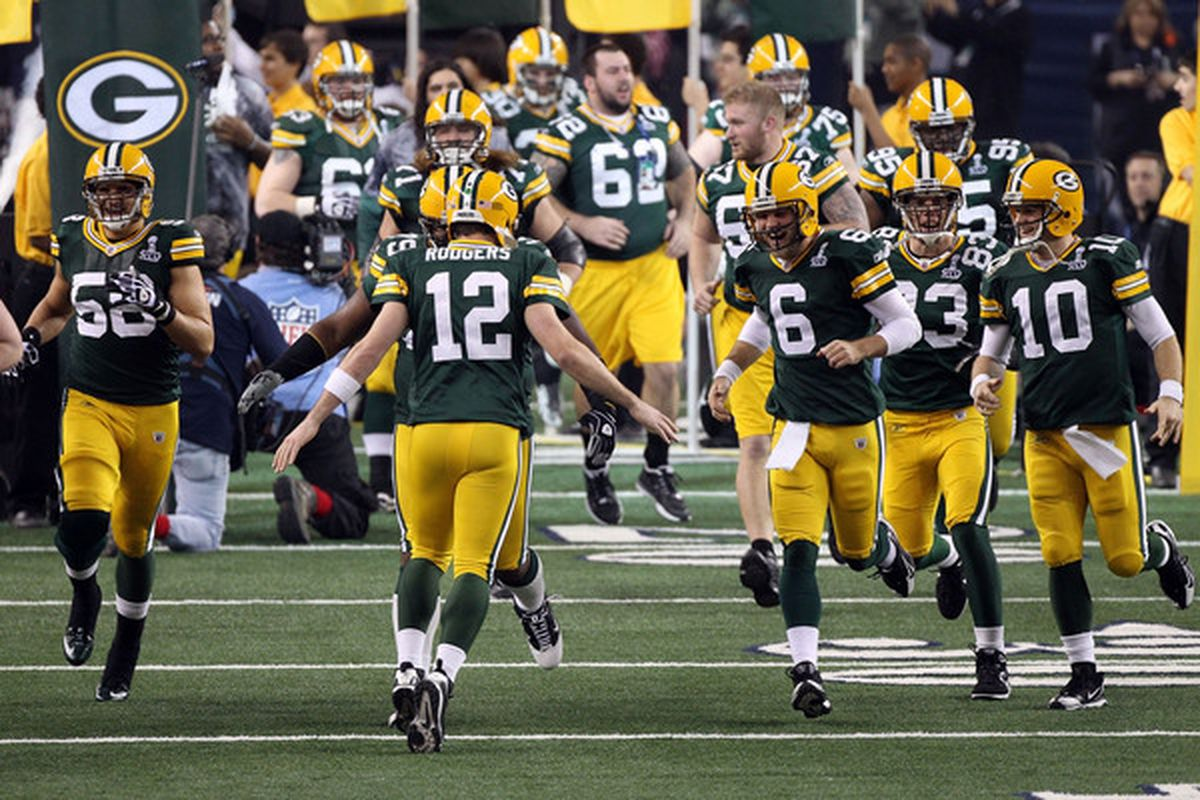 ARLINGTON TX - FEBRUARY 06: Aaron Rodgers #12 of the Green Bay Packers leads his team onto the field prior to Super Bowl XLV at Cowboys Stadium on February 6 2011 in Arlington Texas.  (Photo by Streeter Lecka/Getty Images)
