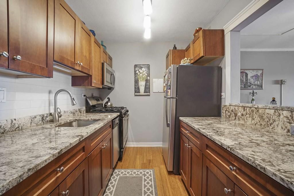 A kitchen with two parallel counters.