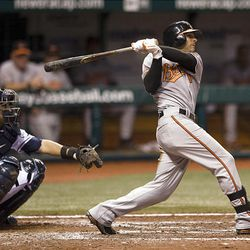 Baltimore Orioles' Brian Roberts hits a grand slam off Tampa Bay Rays  reliever Lance Cormier.