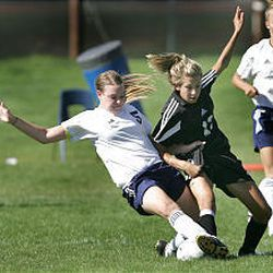 Timpanogos' Megan Richardson and Lone Peak's Lauren Hair battle for ball during Knights' 4-3 win Thursday, the opening day of region play.