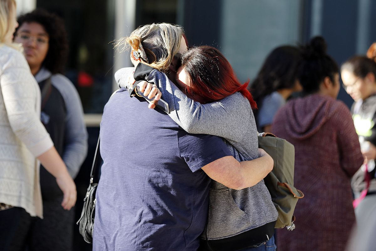 Parents and students hug as they reunite outside Mountain View High School in Orem on Tuesday, Nov. 15, 2016, following a stabbing at the school.