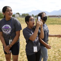 Prefreshman Engineering Program students Yaretzi Cuenca, left, Vina Ngo and Allison Chavez watch their homemade rockets launch outside of Joel P. Jensen Middle School in West Jordan on Thursday, July 22, 2021. The summer enrichment program aims to introduce students to careers in STEM-related fields.