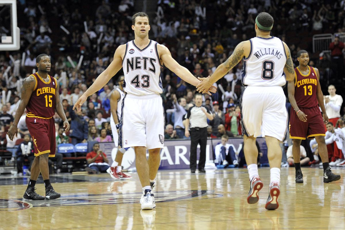 Apr 8, 2012; Newark, NJ, USA;  New Jersey Nets forward Kris Humphries (4) slaps guard Deron Williams (8) hand after a Williams basket in during the second half at  the Prudential Center. Mandatory Credit: Joe Camporeale-US PRESSWIRE
