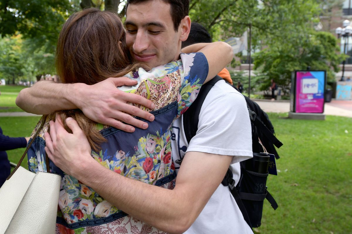 University of Michigan senior and Wolverine Support Network Executive Director Jordan Lazarus hugs Diane Orley on campus at the school in Ann Arbor, MI., Wednesday, Sept. 12, 2018. The peer to peer group is designed to empower students so create a safe co