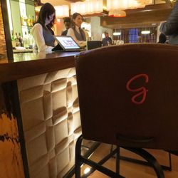"""The bar stools even have the Giada """"G"""" imprint on them."""
