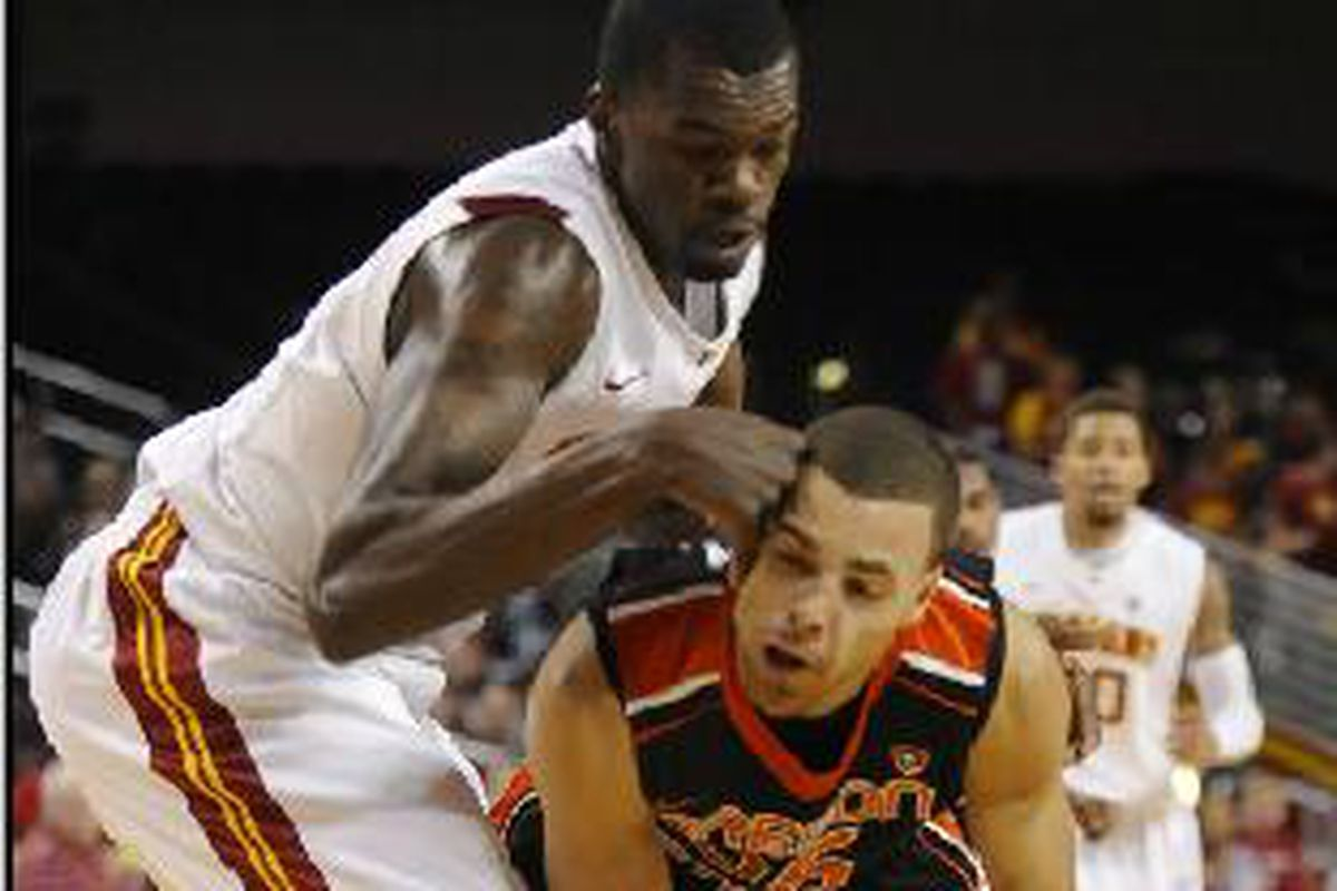Oregon St.'s Roberto Nelson battles USC's Dewayne Dedmon. Nelson posted a game high 26 points, and Dedmon fouled out with 4 minutes left, but the Trojans still beat the Beavers by 1 point.