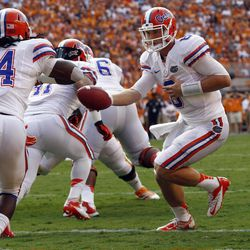 Florida quarterback Jeff Driskel (6) hands the ball off to running back Matt Jones (24) during the first quarter of an NCAA college football game against Tennessee on Saturday, Sept. 15, 2012, in Knoxville, Tenn.