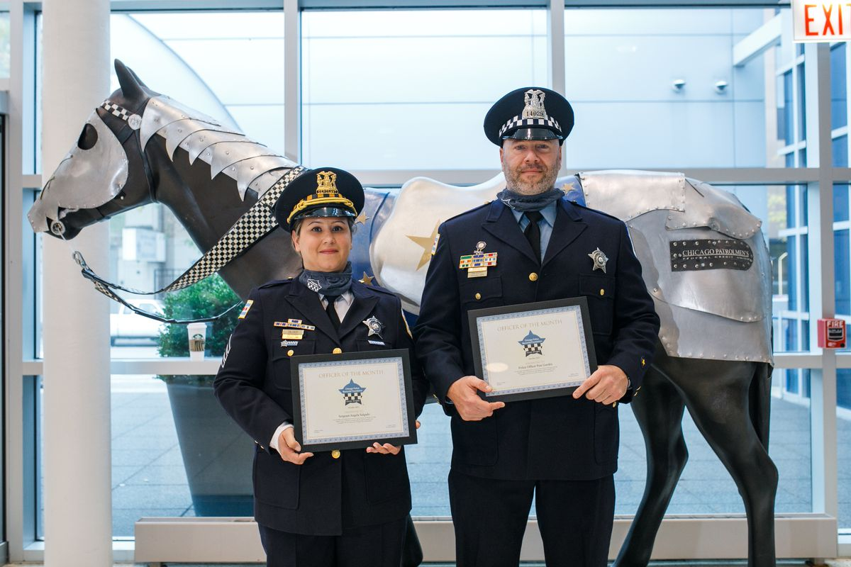 Sgt. Angela Salgado (left) and Officer Pete Gurskis were awarded officers of the month for their efforts to stop a knife-wielding man last year. The officers said they had no other option but to use deadly force. Sergeant Angela Salgado (left) and Officer Pete Gurskis stand with their awards at the Chicago Patrolmen's Federal Credit Union in West Loop, Tuesday morning, Oct. 12, 2021.