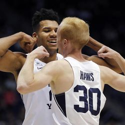 Brigham Young Cougars forward Yoeli Childs and guard TJ Haws celebrate after Haws is fouled by a Mississippi Valley State player during NCAA basketball in Provo on Saturday, Nov. 11, 2017.