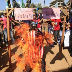 Palestinian Islamists burn an effigy portraying U.S. President Barack Obama during a protest about a film ridiculing Islam's Prophet Muhammad in the Palestinian refugee camp of Ain el-Hilweh near Sidon, Lebanon, Friday, Sept. 14, 2012.