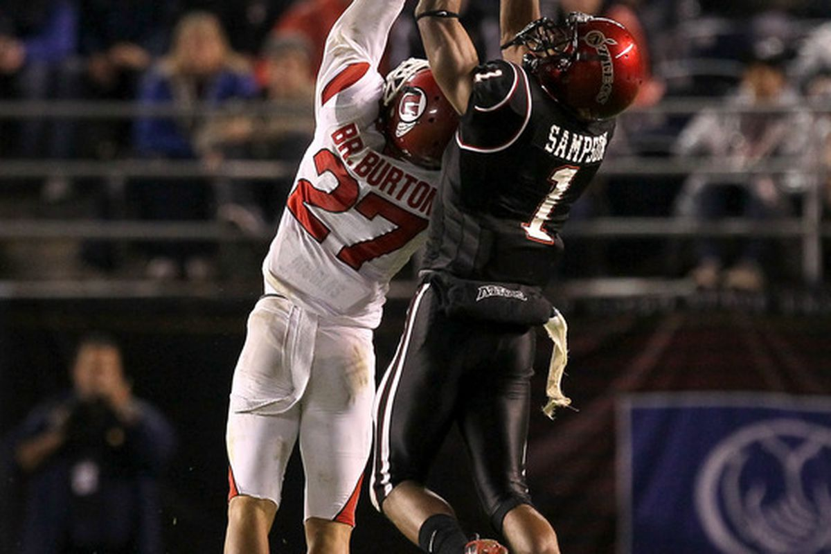 SAN DIEGO:  Wide receiver DeMarco Sampson #1 of the San Diego State Aztecs makes a catch over cornerback Brandon Burton #27 of the Utah Utes at Qualcomm Stadium in San Diego California.  Utah won 38-34.  (Photo by Stephen Dunn/Getty Images)
