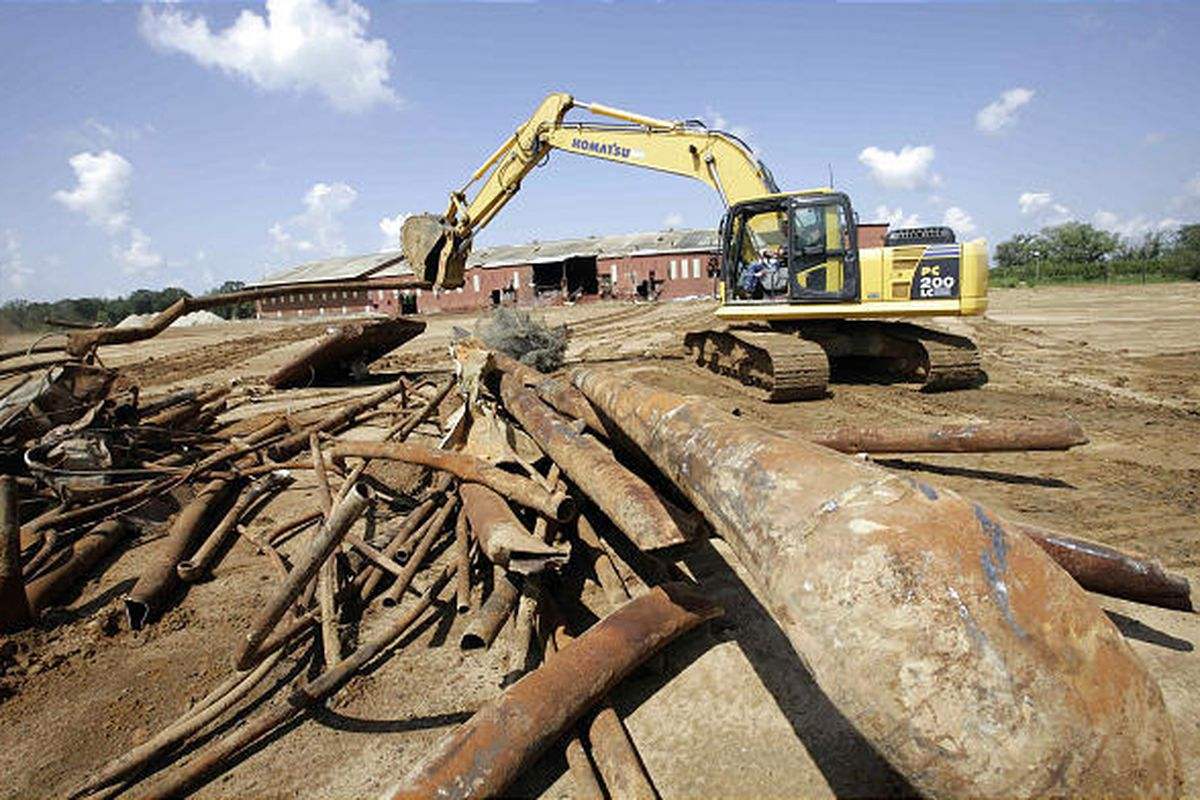 An equipment operator breaks up materials in Headland, Ala., at the American Brass Superfund site, which is ready for the final phase of cleanup.