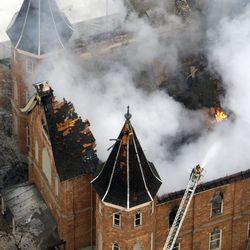 The LDS Provo Tabernacle burns as firefighters try to knock down the flames and hot spots in Provo, Utah, Friday, Dec. 17, 2010.