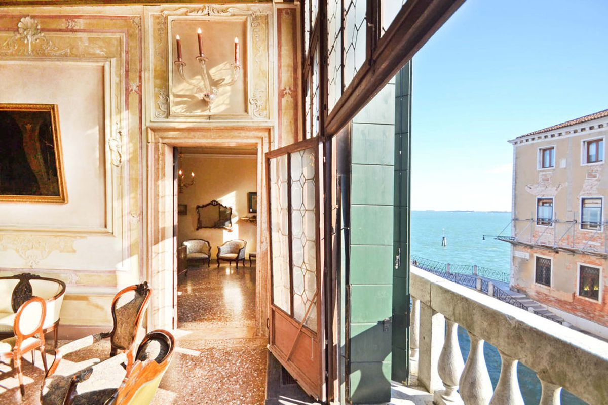 Shot of opulent interior with view out the window to the lagoon.