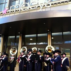 The Herriman High School marching band plays outside the new Macy's store at City Creek during the mall's grand opening Thursday,  March 22, 2012.