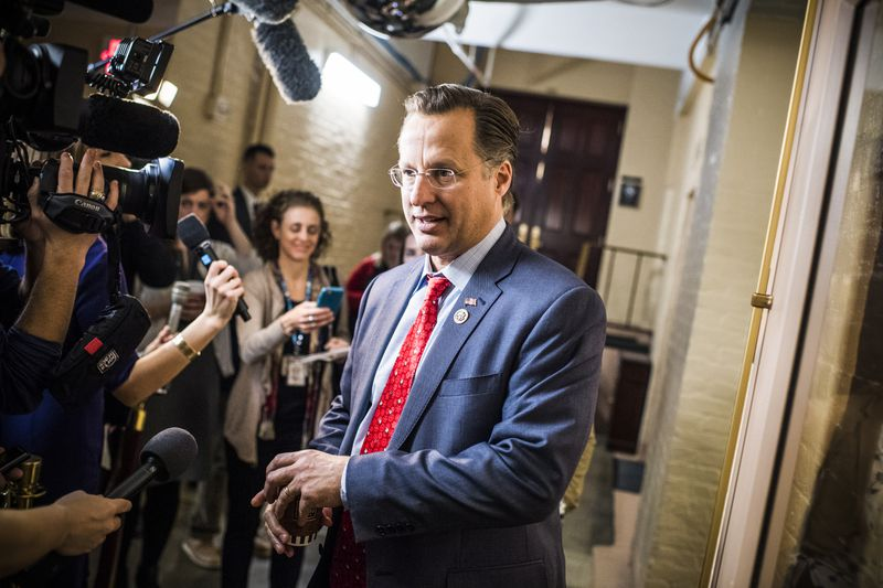 Rep. Dave Brat (R-Va.), talks with reporters outside a meeting of the House Republican Conference in the Capitol on December 19, 2017.