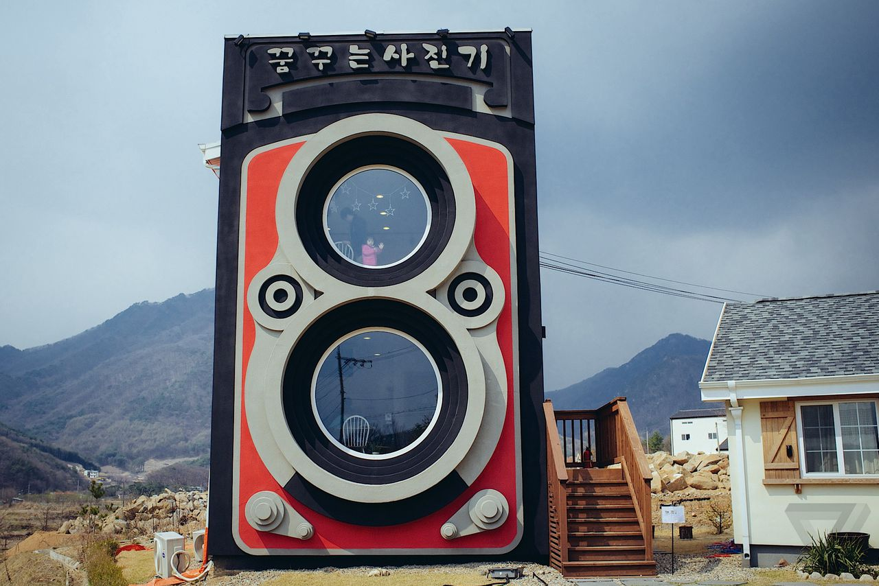 Drinking coffee inside a two story camera the verge welcome to south koreas dreamy camera cafe malvernweather Gallery