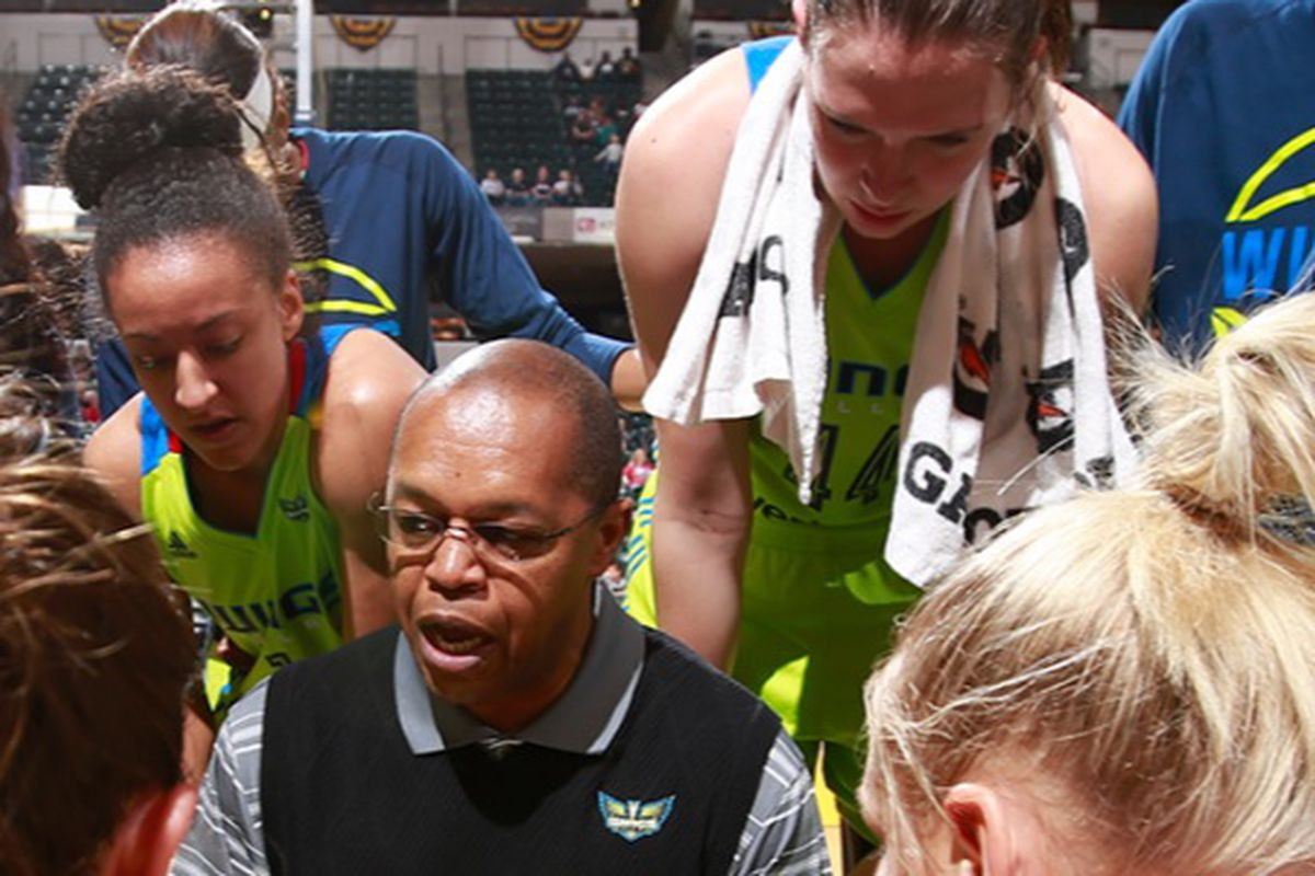 Ruth Hamblin listens in during a timeout in the Dallas Wings' second preseason game.